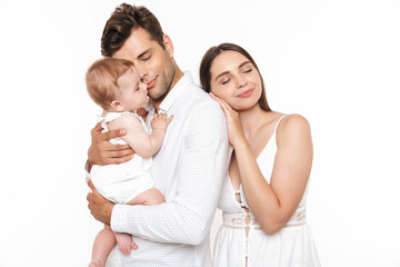 Portrait of a smiling young family with their little baby girl