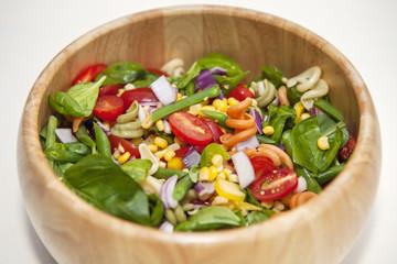 Pasta salad in wooden bowl