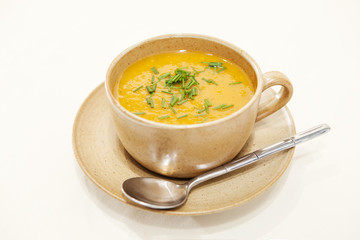 Butternut squash soup in a cup and and saucer