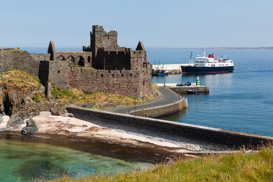 Peel Castle on a summers day with ferry on the sea in the background, Isle of Man, British Isles