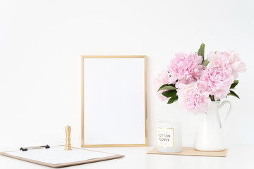 Modern gold portrait a4 frame mock up with a bouquet pink peonies in white jug, gold stamp. Overlay your quote, promotion, headline, or design, great for small businesses, lifestyle bloggers