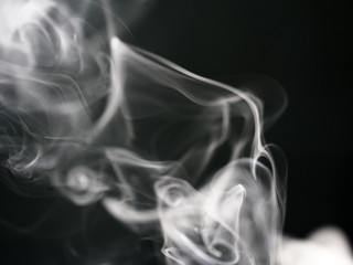 Abstract texture of white smoke isolated on black background
