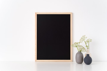 Letter Board mockup with a host in vases. Mockup for headline, design. Template for small businesses, lifestyle bloggers