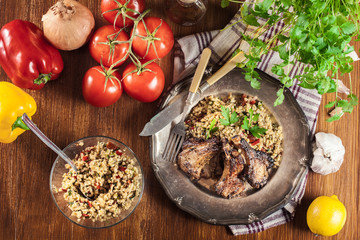Roasted lamb chops served with bulgur wheat