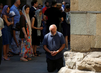 People attend a religious service marking the Day of the Virgin Mary at Sioni Cathedral in Tbilisi