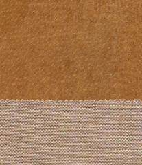 Fabric linen textile on the leather background