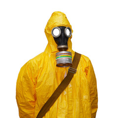 Yellow chemical protective suit with gas mask, isolated on white background. Concept: ecology, chemical pollution, radiation, humor, collage.