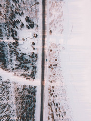 Aerial shot of road in snowy lands