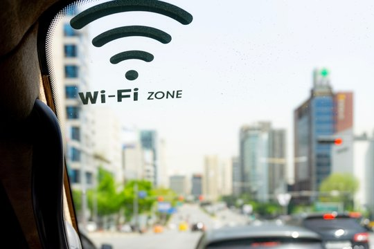 Symbol of wifi facility on vehicle windscreen. In-car internet facility. Trending and need of internet connection. Internet and social media concept. 