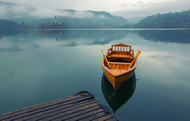 Lonely boat on the water surface of Bled lake, Slovenia