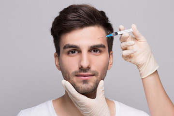 Filler injection for male face in beauty clinic
