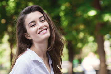 Portrait of happy young woman walking outdoors