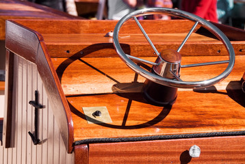 Steering Wheel on a Wooden Antique Boat