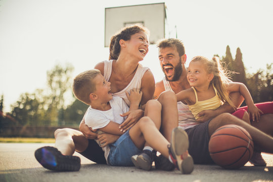 Family after basketball have fun together.