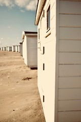 White bath houses at beach.