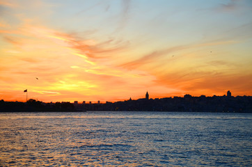 View of the historical district of Fatih from the sea of Marmara, Istanbul, Turkey. Sunset. Beautiful colorful sky.