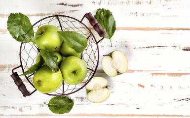 Top view of green apples on white background