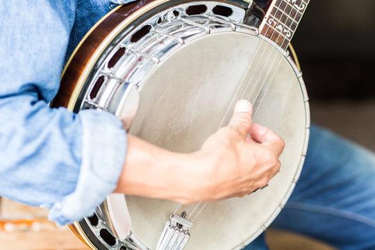 Man playing a banjo.