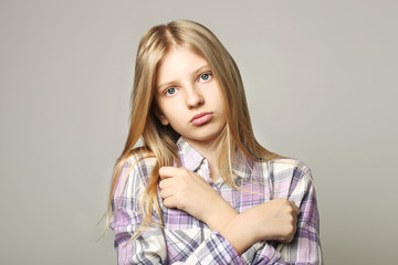 Close up portrait of beautiful teenager girl with sad depressed facial expression. Pretty young woman with long blonde hair looking stressed and worried. isolated background, copy space.