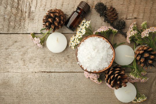 Spa composition on wooden table. Natural aroma oil, sea salt on rustic wooden background. Healthy skin care. SPA concept. Top view with space for text