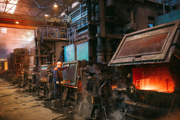Workers in the steel mill.