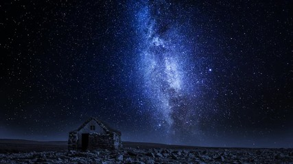 Fototapete - Small stone cottage and moving milky way at night, Iceland, timelapse, 4K