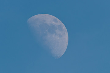 The Moon in a blue sky
