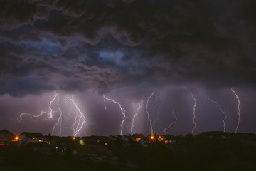 Summer thunderstorm and lightnings. Composite photography.
