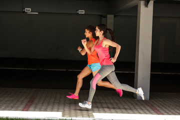 Two female runners jogging.Fitness and jogging concept.Copy space.