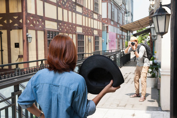 Two young asian traveler enjoy take photo with they camera on sunny day