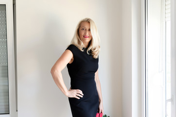 Senior business woman in black dress