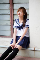 Portrait of thai teen beautiful girl in japanese student uniform happy and relax