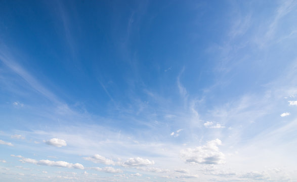 Beautiful blue sky with bright clouds for background photomontage copyspace