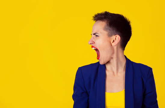 woman in rage in side profile view screaming