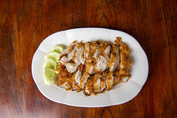 The fried chicken in a dish with cucumber,  eat with rice as foods that are beneficial to the body