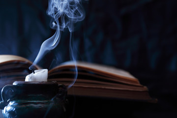 Extinguished Candle Near Book