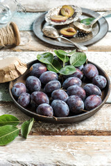 Plum fruits rustic wooden background Jam marmalade