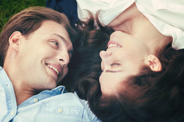 Loving couple lying on the grass