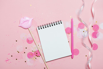 Empty note pad - mock up template with pink confetti on pink background