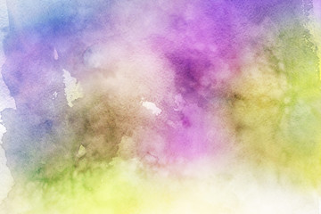 Colorful watercolor ombre leaks and splashes texture on white watercolor paper background. Natural organic shapes and design.