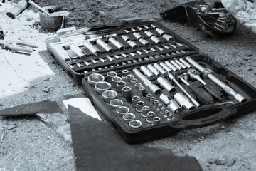 A set of socket keys in a box, a black and white photo. Concept of bike repair.