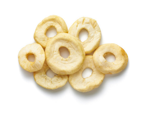 Dried sliced apple rings isolated on white background. Top view.