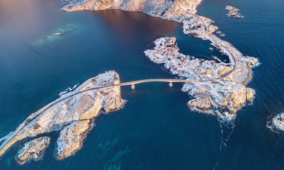 Aerial view on the mountains and sea bay on the Lofoten islands, Norway. Houses and bridges near mountains. Natural background in the Norway