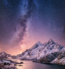 Poster Lichtroze Mountans and reflection on the water surface at the night time. Sea bay and mountains at the night time. Milky way above mountains, Norway. Beautiful natural landscape in the Norway