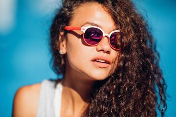 Portrait of fashionable long curly dark hair lady making selfie posing beside exotic summer beach hot summer