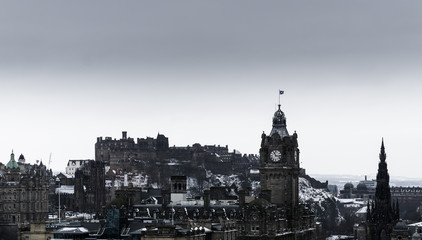 city view with Edinburgh Castle and Balmoral clock tower in the snow