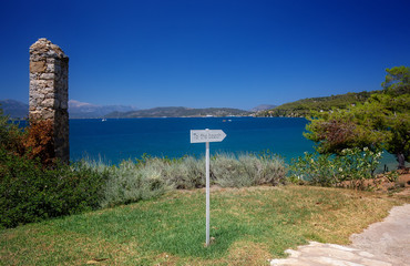 Travel Greece. To the beach sign. Spectacular view on one of the most beautiful beaches in Poros Island. Summer holiday