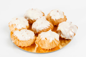 Traditional french Profiteroles, choux pastry with whipped cream inside. Group of french dessert on white background.
