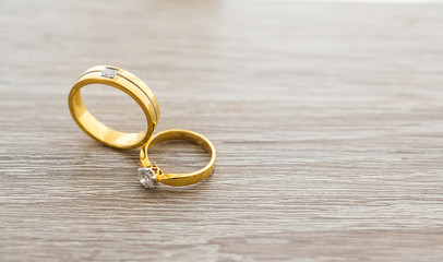 Diamond ring, wedding ring, Wedding Ring bride price. Wedding symbols. Wedding ceremony. image for objects and article.rings on wooden surface, symbol of couple