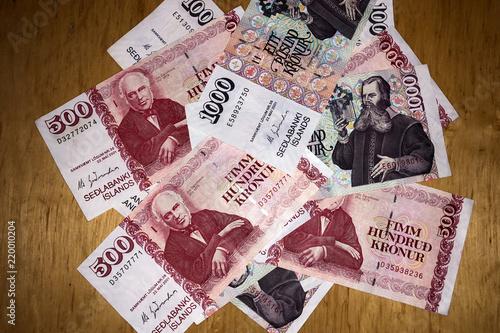 Icelandic Cash Money Of Iceland Several Krona Bills On Wooden Table